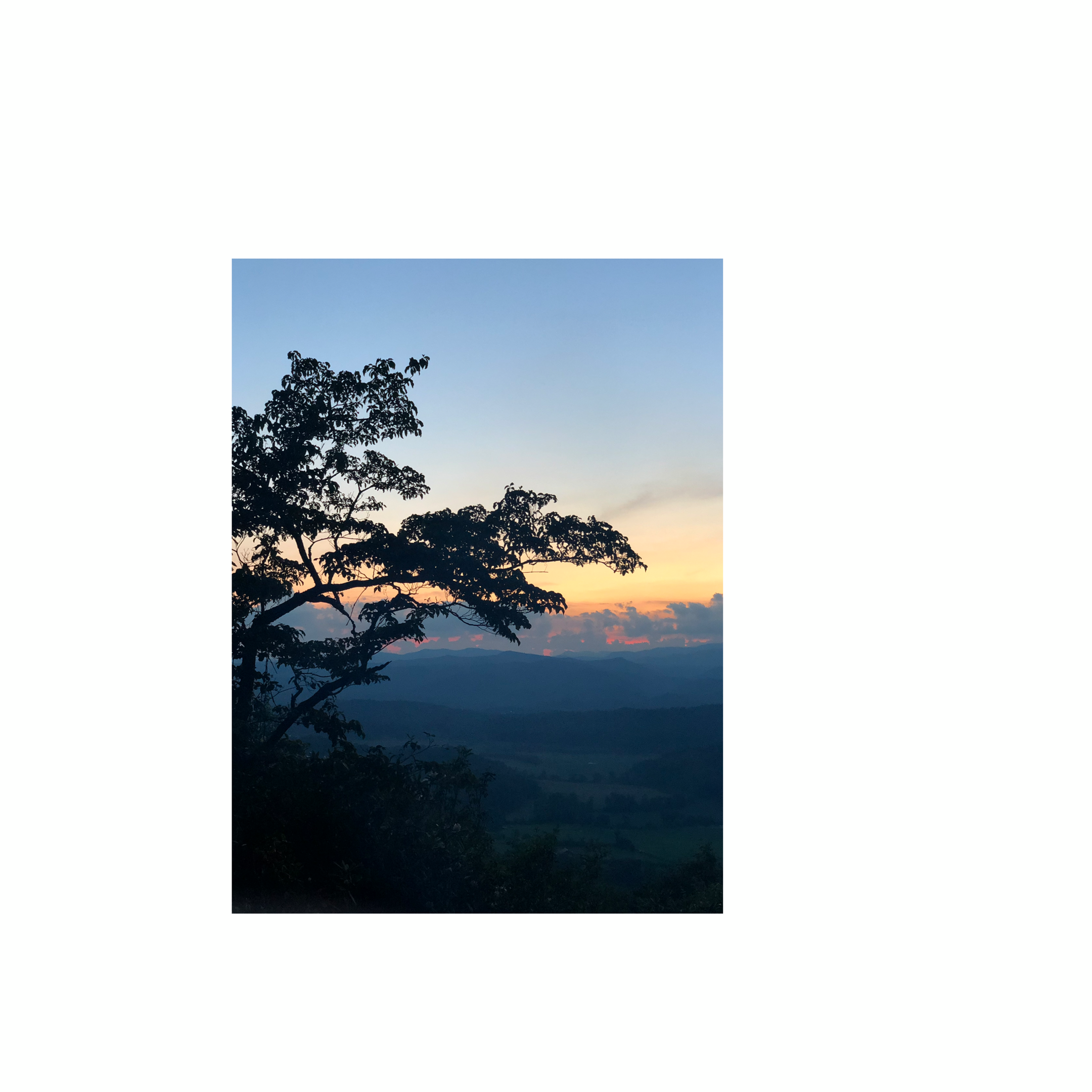 view from a mountain at sunset