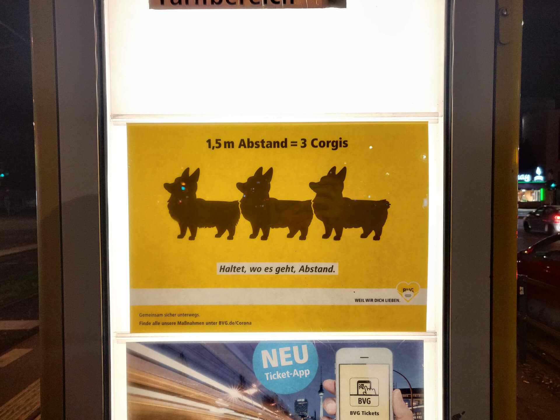 "A new BVG campaign poster that reads ""1,5m Abstand = 3 Corgis"""
