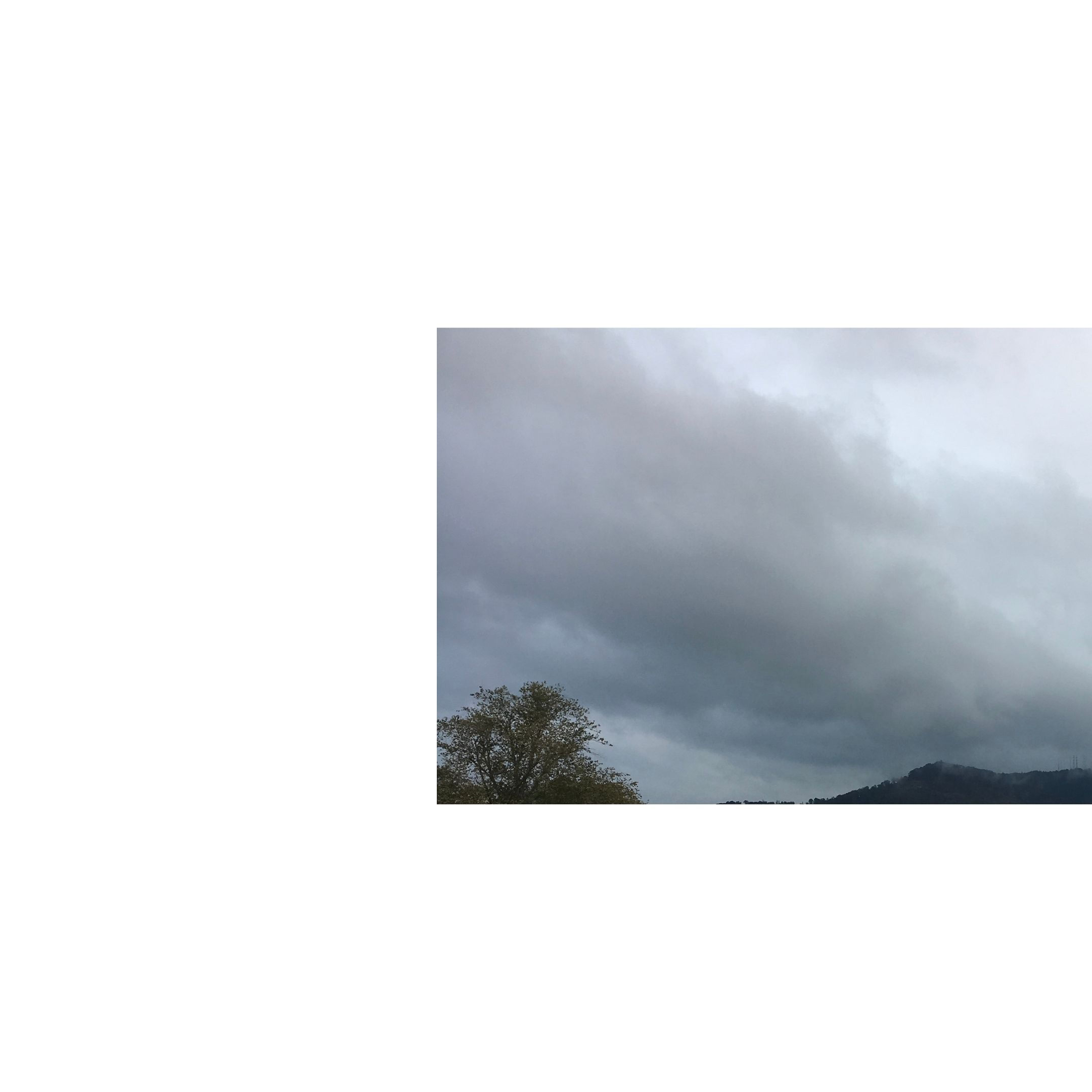 clouds and mountain top with tree