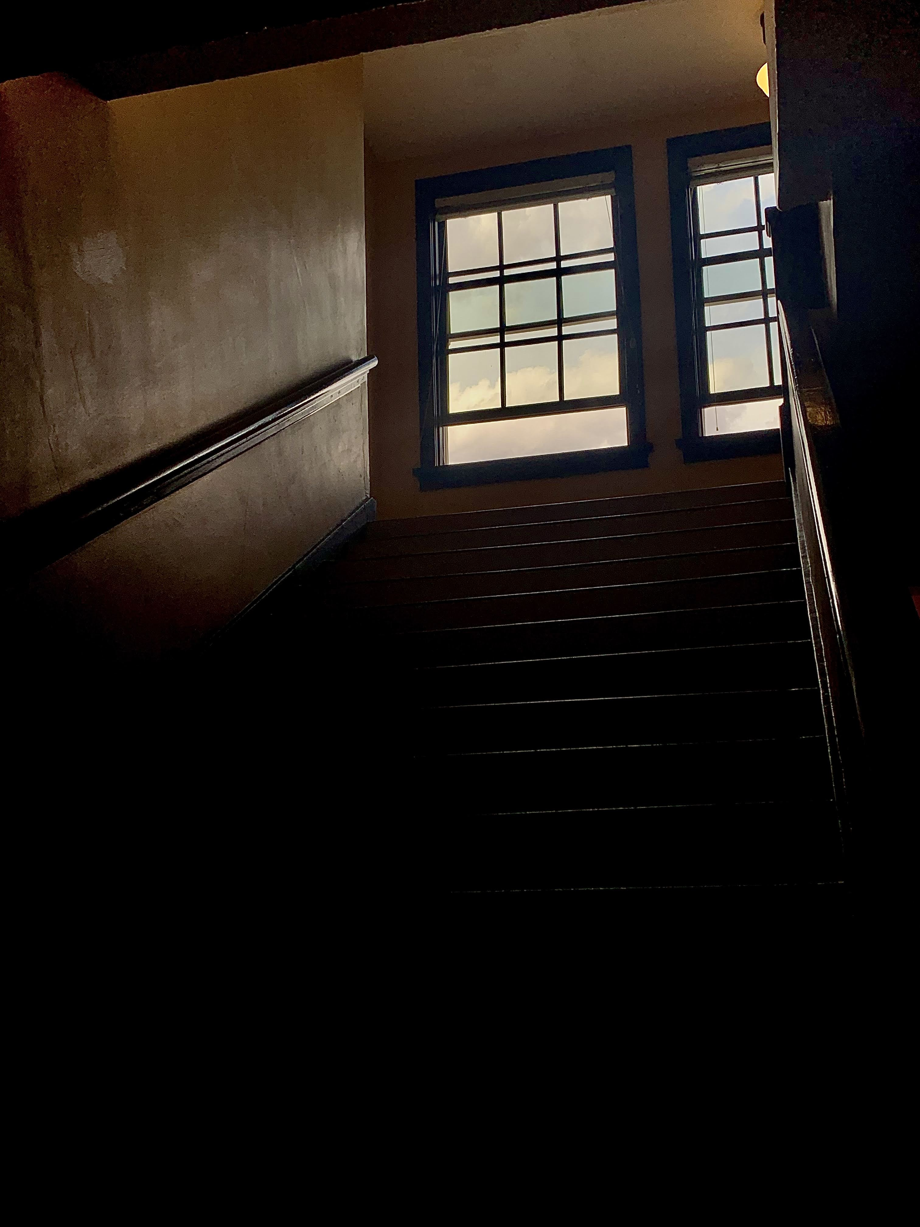 a staircase and an open window
